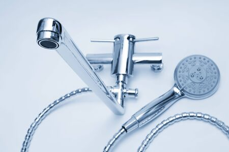 watertap: modern metal faucet and shower close up