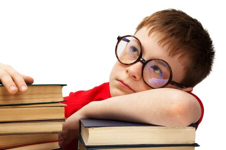 bibliomania: boy with glasses and books on white background