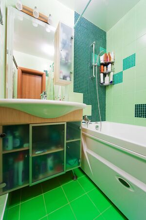 Fashionable green bathroom in a modern apartment Stock Photo - 5150169