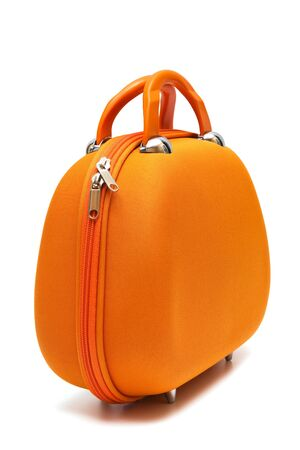 orange large suitcase on a white background photo