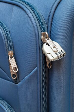 lugage: padlock with figures in modern suitcase close-up