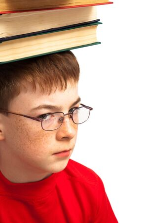 boy on head with books on white background photo
