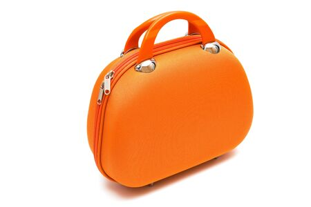 orange large suitcase on a white background photo
