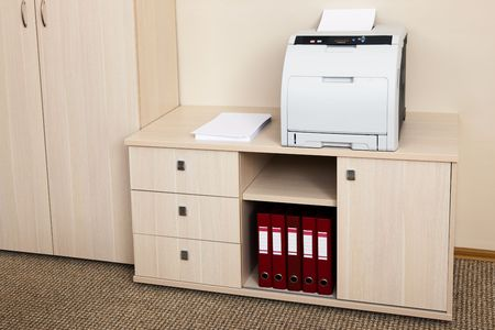 black carpet: printer from the cabinet in a modern office Stock Photo