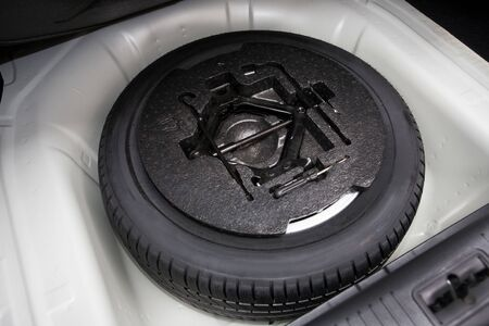 spare tire in the trunk of a modern car photo