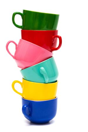 Beautiful color cups on a white background photo