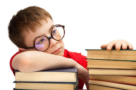 boy with glasses and books on white background photo