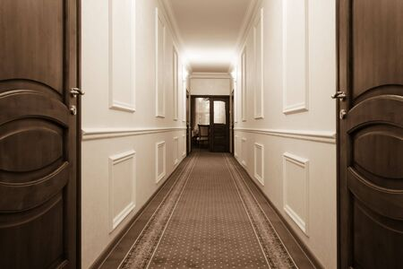white trim: beautiful long corridor with a view of the room