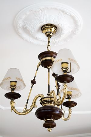 beautiful bronze chandelier in a modern apartment Stock Photo - 5401323