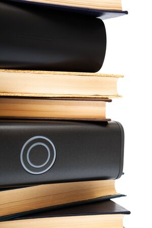 hard drives, and old books on white background photo