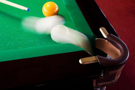 The sphere which slides in a billiards pocket photo