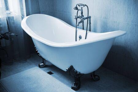 selenium: The beautiful old faucet in a bathroom