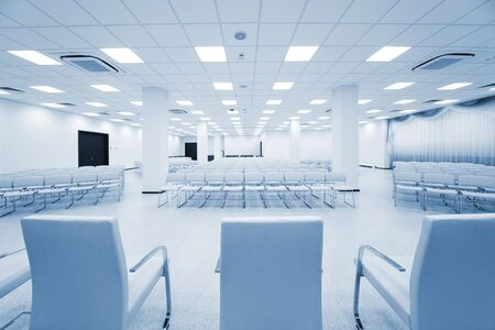 lecture theatre: large and modern white auditorium with blue curtains Stock Photo