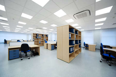 wood ceiling: desks and bookcases in the modern office