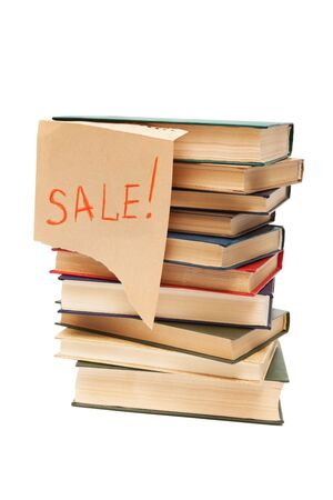 sale of old books on white background photo