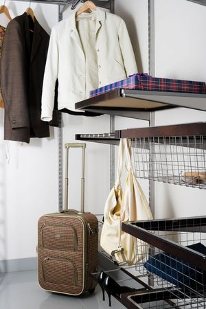 organized home: fashionable and beautiful clothes in the wardrobe Stock Photo