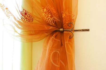 dcor: Beautiful translucent orange curtains in an apartment