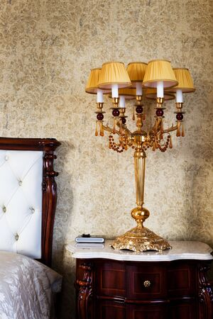 Beautiful lamp at a bed in a modern bedroom Stock Photo - 5711771