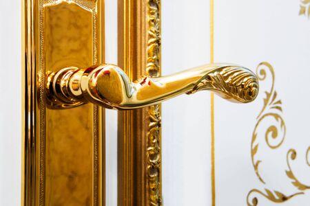 door knob: white door with the new gold handle Stock Photo