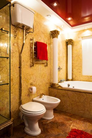Fashionable yellow bathroom in a modern apartment photo