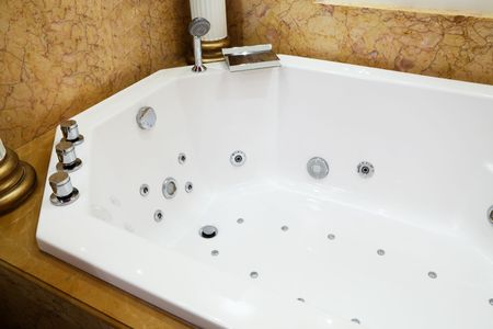 beautiful big bath in the marble bathroom photo