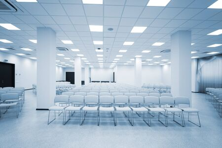 lecture room: large and modern white auditorium with blue curtains Stock Photo