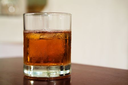 glass from whiskey on a wooden table photo