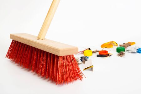 broom handle: Cleaning the modern red broom mixed trash