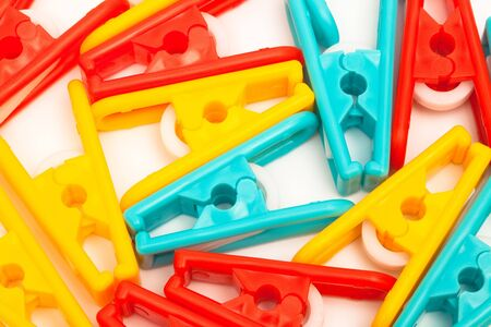 yellow, red and blue clothespins close up photo