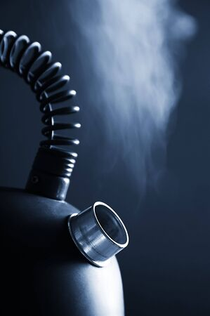 boiling water: blue boiling kettle on a dark background