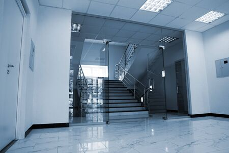 Glass doors with a kind on a marble staircase Stock Photo - 6195168