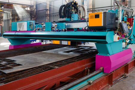 new and powerful metalworking machine in modern workshop photo