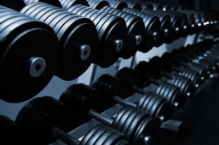 Heavy sports dumbbells in modern sports club Stock Photo - 6442396