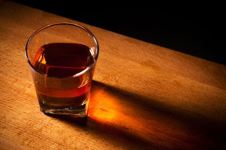 neat: glass from whisky on a wooden table