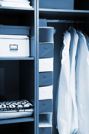 Clothes and towels in a wooden wardrobe Stock Photo - 6536588