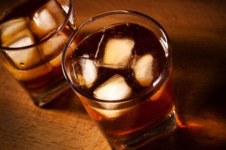 temperance: glasses from whisky on a wooden table Stock Photo