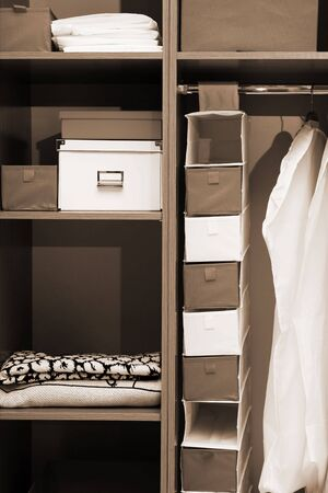 Clothes and towels in a wooden wardrobe photo