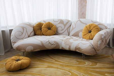 beautiful sofa near the window in the apartment Stock Photo - 7622475
