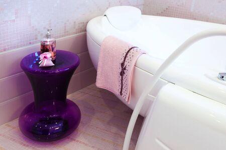 pedestal sink: beautiful big bath in the pink bathroom Stock Photo