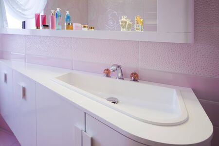 modern purple bathroom in a modern apartment photo