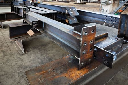 steel factory: new welded metal beams on modern plant Stock Photo