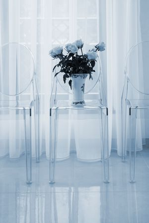 Bouquet of flowers on a chair in modern flat photo