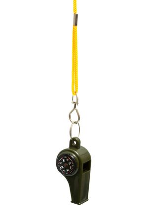 green whistle with a compass on a yellow cord photo