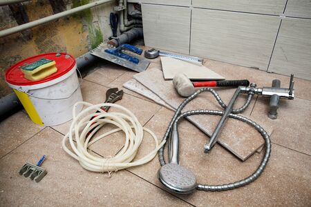 different tools for repair in the bathroom photo
