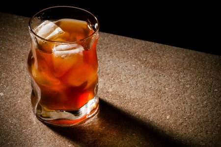 temperance: glasses from whiskey on a wooden table