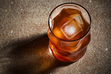 temperance: glasses from whiskey on a marble table Stock Photo