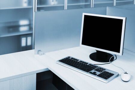 computer behind the glass in a modern office photo