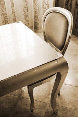 Table and chair on kitchen in a modern apartment photo
