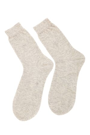 beige and beautiful to socks on a white background photo