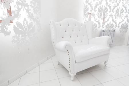 wide white armchair in a modern apartment photo